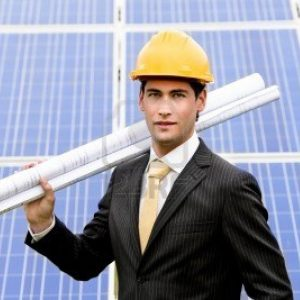 10809303-male-engineer-at-solar-power-station-holding-blueprints